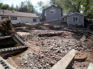 House on the right was moved off its foundation, in front of me used to be a driveway. None of these rocks were here a month ago, 9/29/13.