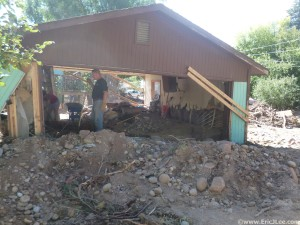 Chris and Misti starting the cleanup in Ed's garage, the river deposited all the rocks and mud here (and throughout town), 9/29/13.