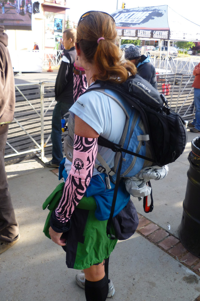 Pacer at the Leadville 100 carrying both her own pack AND her runner's pack. Muling is allowed at Leadville.