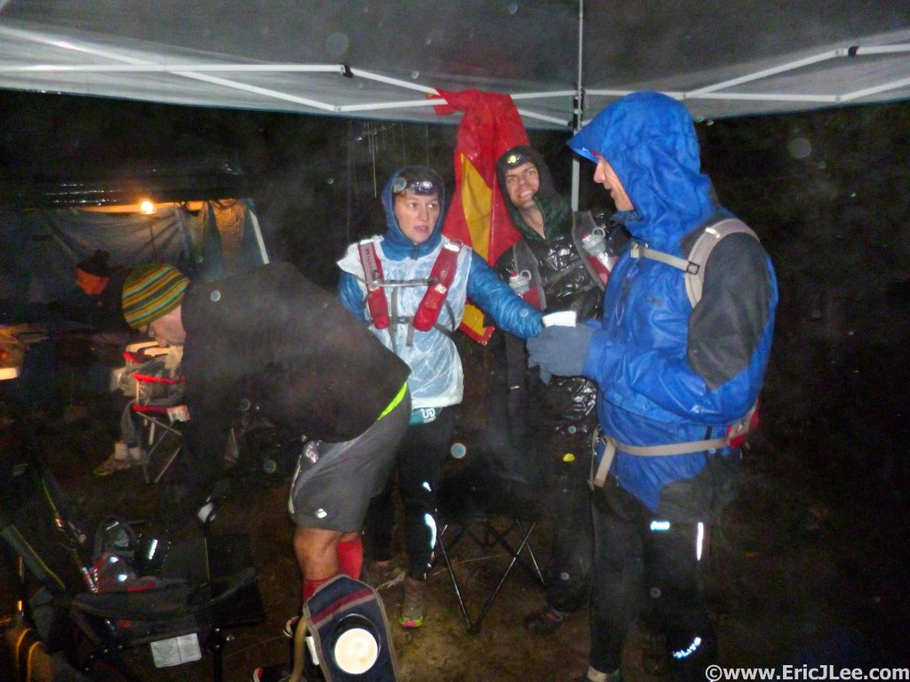 Jason and other runner hunkered down under our small tarp at Gibson Basin as the rain pounds us. No one was dry, but the Aid Station workers were still awesome.