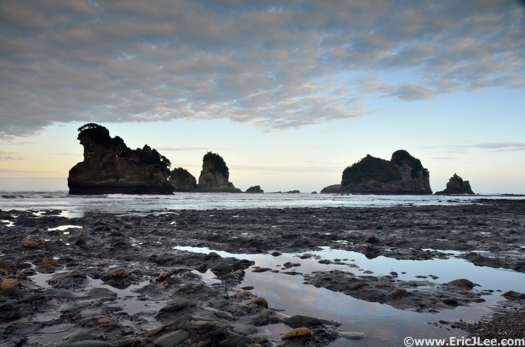 Low-tide walk on Motukeikei Beach, our own private tidal shelf and sea stacks.