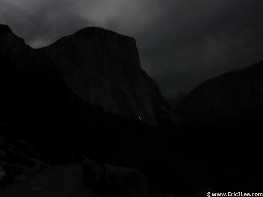 El Cap in the moonlight with a solitary headlamp bivied on the wall.
